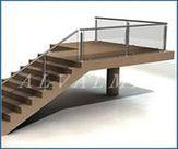 Tramo de escaleras y meseta de barandilla de aluminio acristalada