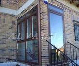 Cerramiento de aluminio de entrada en vivienda unifamiliar de Casarrubuelos, Madrid