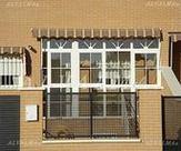 Cerramiento de aluminio de entrada en vivienda de Valdemoro, Madrid