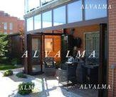 Cerramiento con puertas plegables de aluminio en Madrid