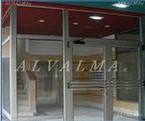 Puerta de aluminio para Portal instalada en Madrid